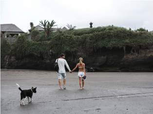 young-couple-walking-with-dog